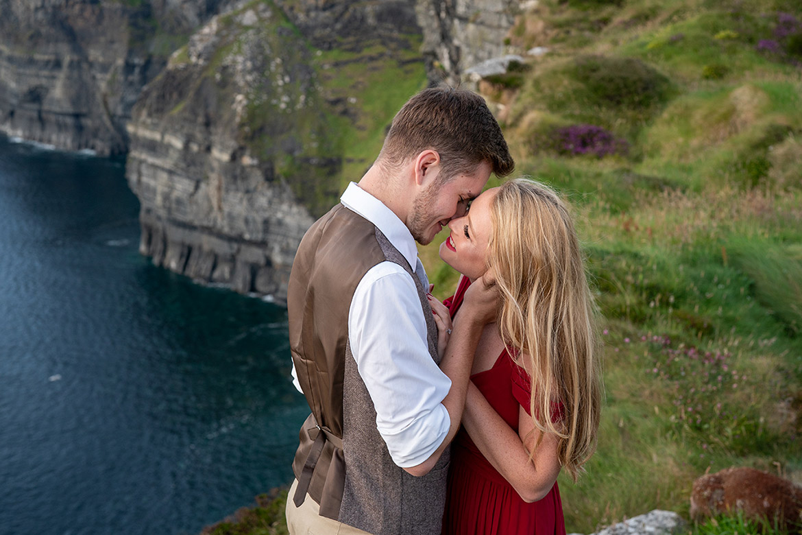 Engagement photo shoot overlooking the sea on the coast of ireland at the cliffs of Moher