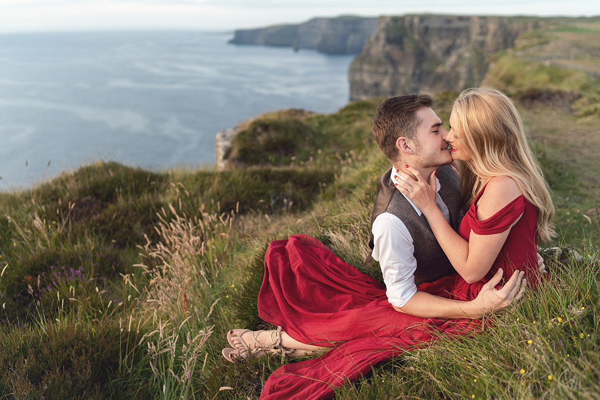 Engagement photography at the Cliffs of Moher in Ireland at sunset by Gerard Conneely Photography photo