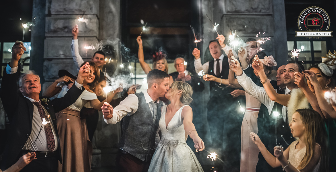 Wedding couple with sparklers at the Hardiman hotel in Galway photo by gerard conneely photography