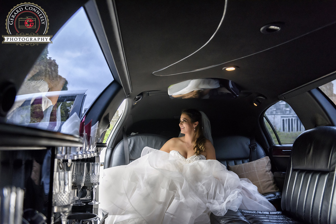 Bride arriving at Dromoland Castle in a wedding car