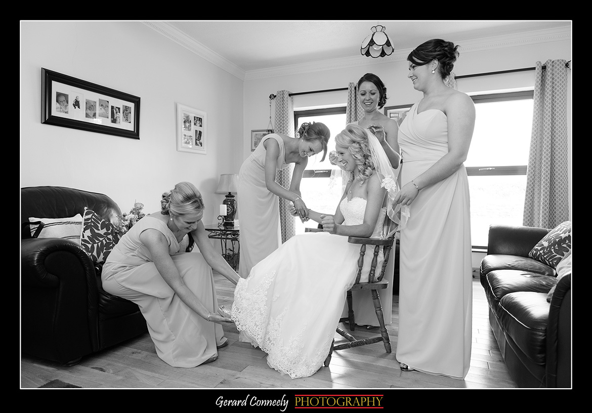 Bridal Preparations bridemaids helping bride get ready at galway wedding