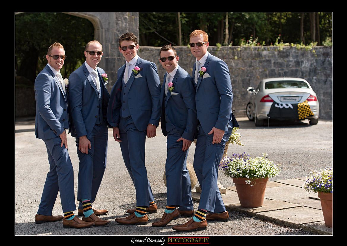 groomsmen at lough cutra castle showing their socks