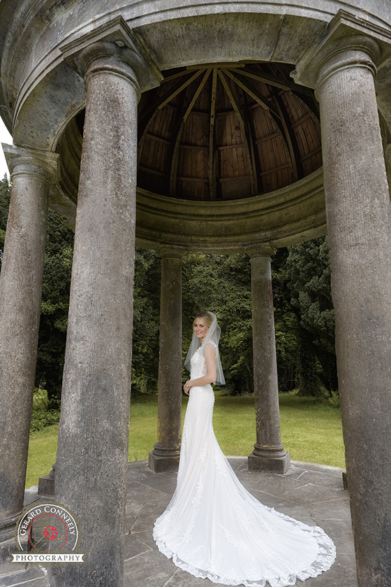 Bride at the temple of mercury at Dromoland Castle on her wedding day