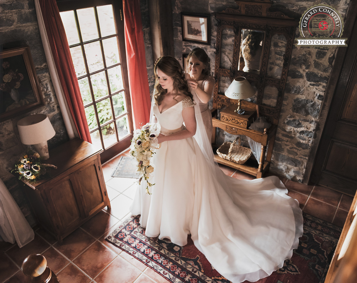 bride getting ready at an irish castle wedding photography by gerard conneely