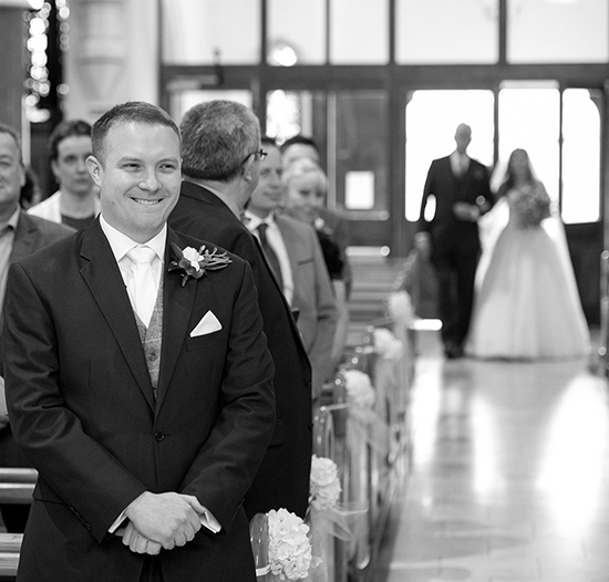 walking up the aisle grooms expression getting married wedding photography