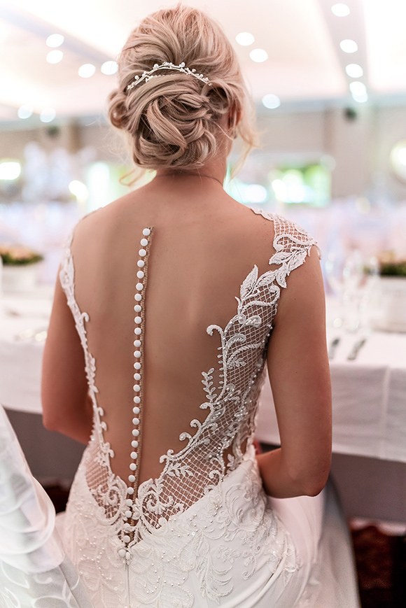 Beautiful wedding dress back detail at the Galway bay hotel in Galway wedding photography by Gerard Conneely